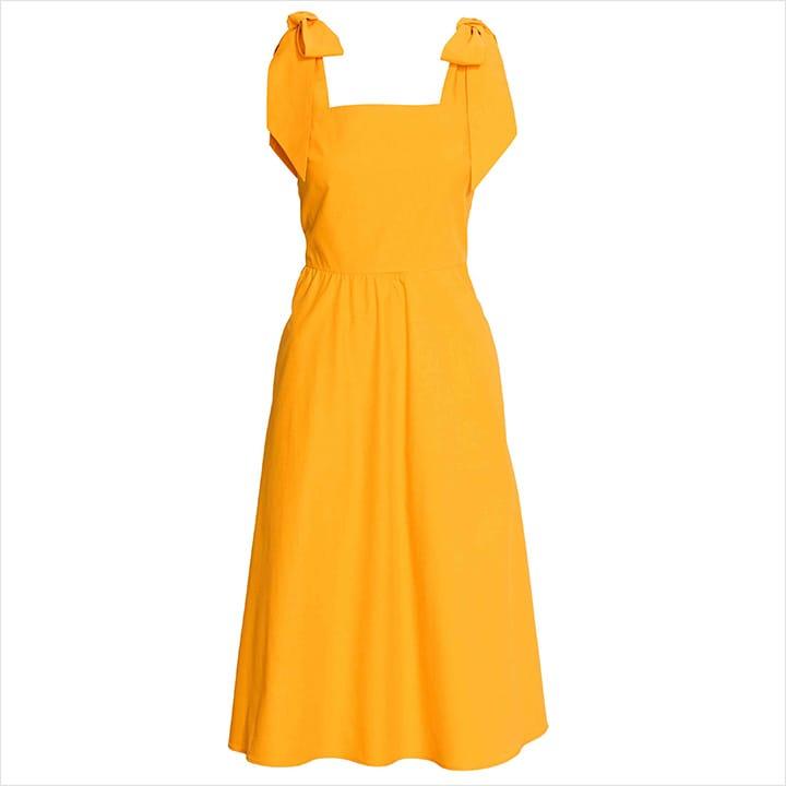 어깨에 리본 디테일로 사랑스러움을 더한 옐로 원피스. H&M, 가격 미정.